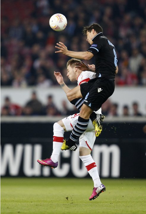 VfB Stuttgart's Alexandru Maxim challenges Lazio's Hernanes during their Europa League soccer match in Stuttgart