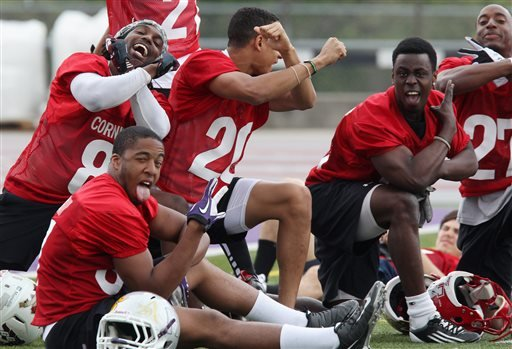 Players pose for the camera during the final drills in preparation for the Canadian Interuniversity Sport (CIS) 11th annual East West Bowl, the All-Star showcase game primarily for CFL-draft-eligible