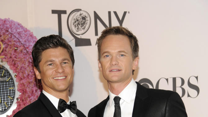 Host Neil Patrick Harris, right, and David Burtka arrive at the 66th Annual Tony Awards on Sunday June 10, 2012, in New York. (Photo by Evan Agostini /Invision/AP)
