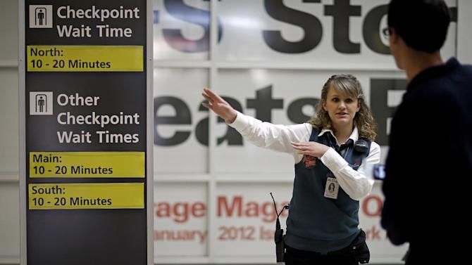 Customer service representative Julia Jacoby directs a traveler to the nearest security checkpoint at Hartsfield-Jackson Airport, Wednesday, Nov. 21, 2012, in Atlanta. Feeling the pinch of the sluggish economic recovery, many Americans setting out on the nation's annual Thanksgiving migration had to sacrifice summer vacations, rely on relatives for airfare or scour the Web for travel deals to ensure they made it home. (AP Photo/David Goldman)