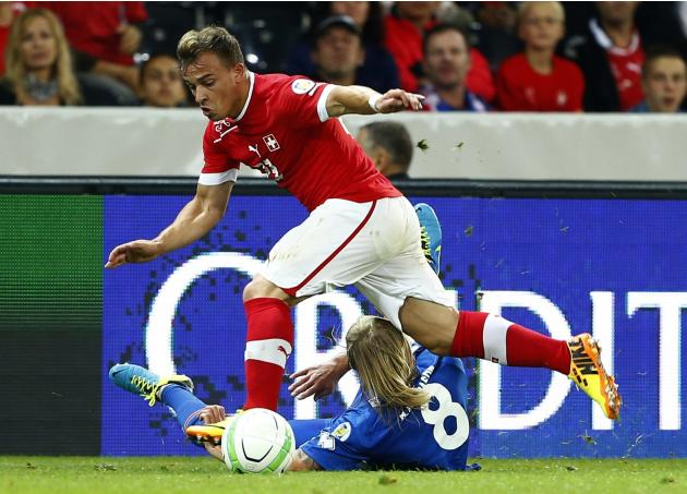 Switzerland's Shaqiri fights for the ball with Iceland's Bjarnason during their 2014 World Cup qualifying soccer match in Bern