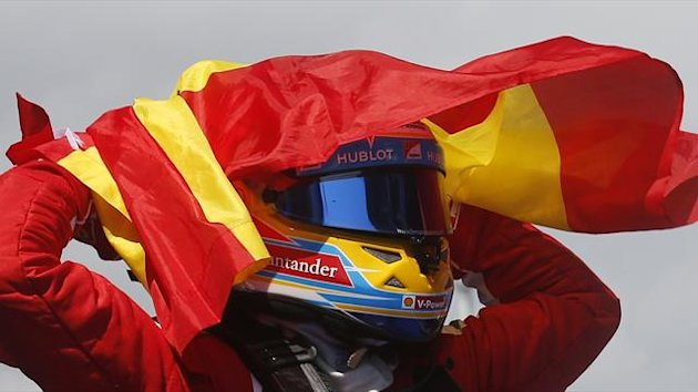 Fernando Alonso celebrates winning the Spanish GP (Reuters)