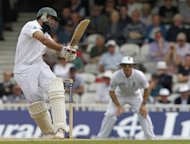 Hashim Amla of South Africa hits a shot during day 3 of the Test match between England and South Africa at the Oval in London. South Africa were 403 for two at the close, a lead of 18 runs with eight first innings wickets standing