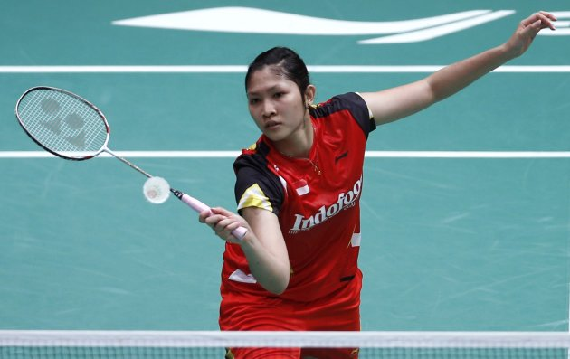 Indonesia's Lindaweni plays a shot during her women's singles match against China's Li at the quarterfinals of the Sudirman Cup World Team Badminton Championships in Kuala Lumpur