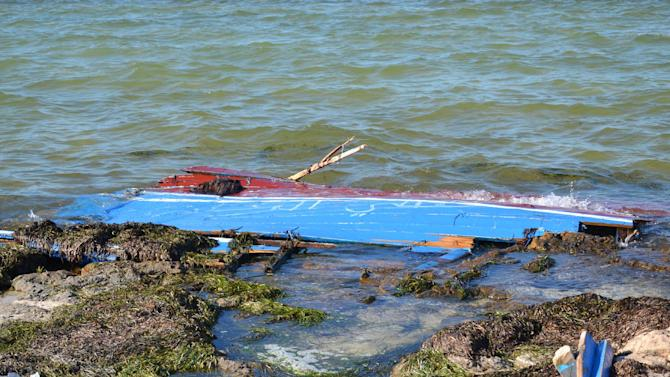 A picture taken on August 29, 2014 shows what remains of a boat carrying illegal migrants from Libya that sank off the shores of the coastal town of Ben Guerdane, in southeast Tunisia