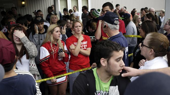 Students wait for family members at Shoultes Gospel Hall church, after an active shooter situation at Marysville-Pilchuck High School, in Marysville, Washington