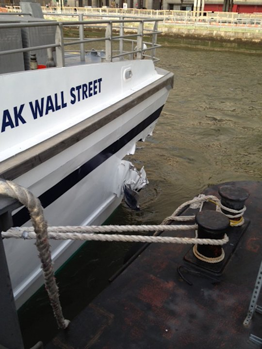 A hole is torn near the bow of the Seastreak Wall Street ferry after it banged into the mooring as it arrived at a pier in New York's financial district Wednesday, Jan. 9, 2013. Police and fire offici