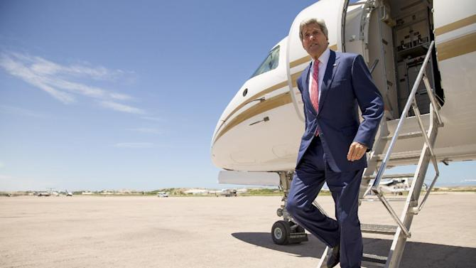 U.S. Secretary of State John Kerry arrives at the airport in Mogadishu, Somalia Tuesday, May 5, 2015. Kerry made unannounced trip to Somalia in a show of solidarity with the government trying to defeat al-Qaida-allied militants and end decades of war in the African country. He is the first top U.S. diplomat ever to visit Somalia. (AP Photo/Andrew Harnik, Pool)