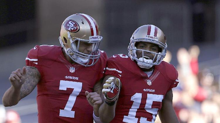 San Francisco 49ers quarterback Colin Kaepernick (7) celebrates with wide receiver Michael Crabtree (15) after they connected on a 49-yard touchdown pass against the Arizona Cardinals during the second quarter of an NFL football game in San Francisco, Sunday, Dec. 30, 2012. (AP Photo/Marcio Jose Sanchez)