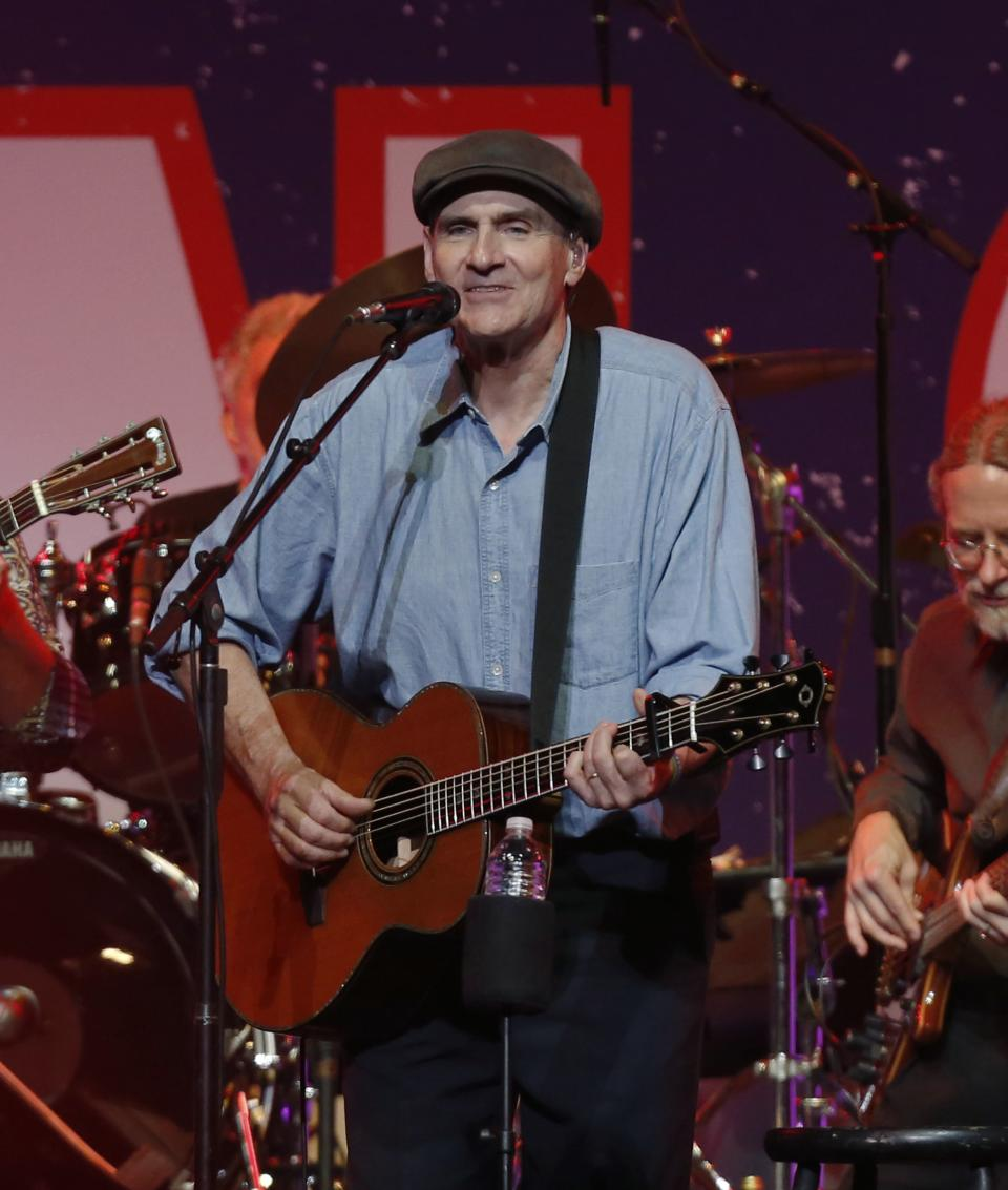James Taylor performs at the Boston Strong Concert: An Evening of Support and Celebration at the TD Garden on Thursday, May 30, 2013 in Boston. (Photo by Bizuayehu Tesfaye/Invision/AP)
