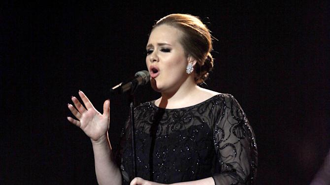FILE - In this Feb. 15, 2011 file photo, Adele performs on stage during the Brit Awards 2011 at The O2 Arena in London. Adele will make her first appearance performing at MTV Video Music Awards, airing Aug. 28, in Los Angeles.  (AP Photo/Joel Ryan, file)