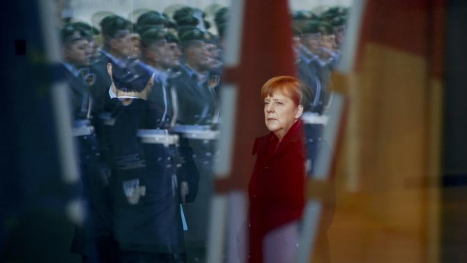 German Chancellor Merkel is pictured through a window as she waits for Polish Prime Minister Szydlo at the Chancellery in Berlin