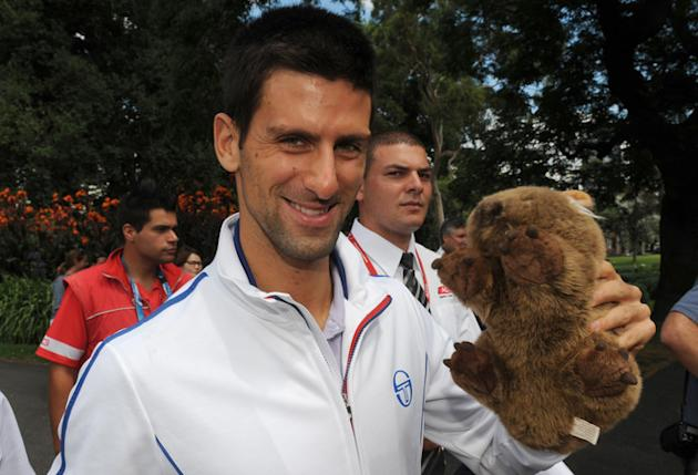 Novak Djokovic Of Serbia Carries AFP/Getty Images