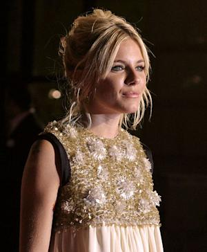 Sienna Miller was seen flashing a new ring.