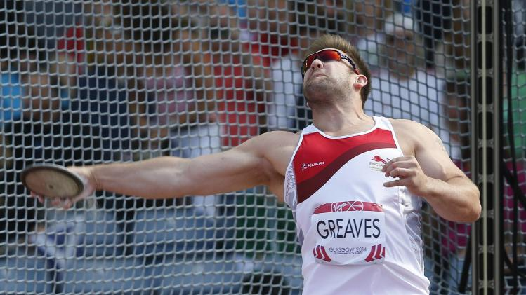 England's Greaves competes in the Men's Para-Sport Discus Throw F42/F44 Final at the 2014 Commonwealth Games in Glasgow, Scotland,