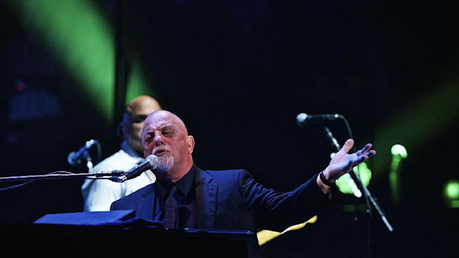 Billy Joel performs for a record 65th time at Madison Square Garden on Wednesday, July 1, 2015, in New York. (Photo by Robert Altman/Invision/AP)