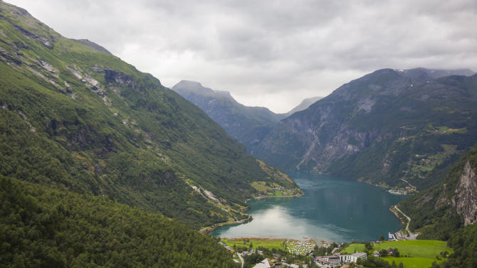 This undated image released by Disney Cruise Line shows a scenic view of Norwegian Fjords. During new Disney Cruise Line sailings to Norway in summer 2015, guests will discover breathtaking natural wonders such as magnificent mountain ranges and majestic fjords while experiencing the enchanting Scandinavian culture. As part of the 2015 Norwegian Fjords itinerary, the Disney Magic sails to exciting new ports steeped in Viking history. (AP Photo/Disney Cruise Line, Jimmy DeFlippo)