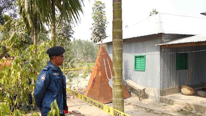A policeman stands guard where a top Hindu priest was killed in the remote northern district of Panchagarh, Bangladesh on February 21, 2016