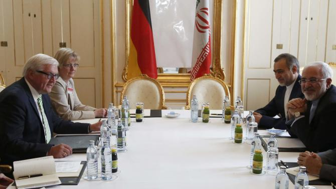 German Foreign Minister Steinmeier and Iranian Foreign Minister Zarif wait for the start of a bilateral meeting in Vienna