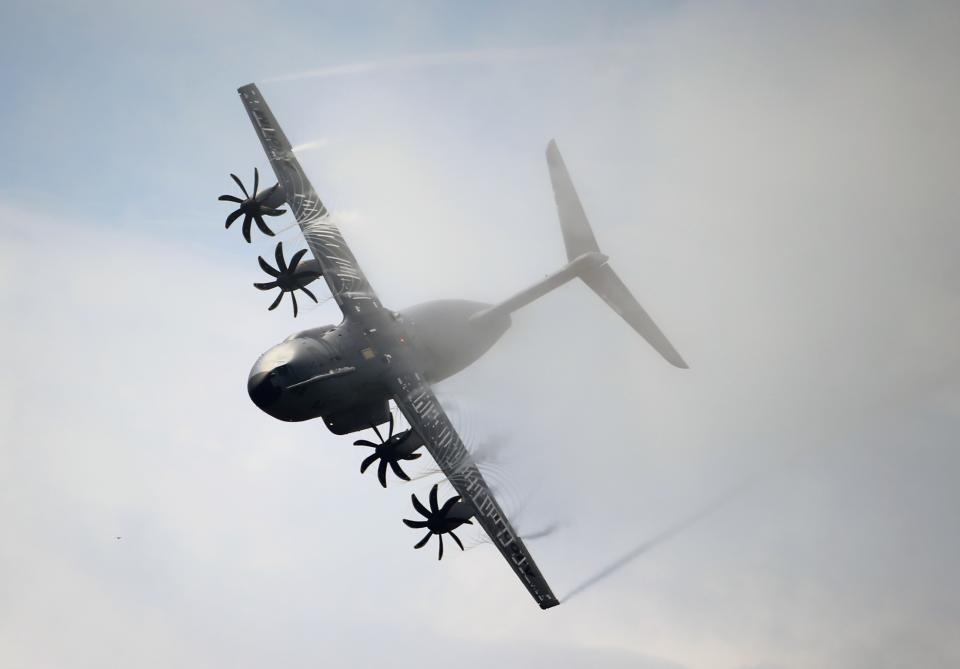 An Airbus A400M performs its demonstration flight during the 50th Paris Air Show at Le Bourget airport, north of Paris, Thursday, June 20, 2013. (AP Photo/Francois Mori)