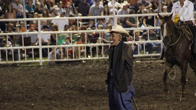 "This photo provided by Jameson Hsieh shows a clown wearing a mask intended to look like President Obama at the Missouri State Fair. The announcer asked the crowd if anyone wanted to see ""Obama run down by a bull,"" according to a spectator. ""So then everybody screamed. ... They just went wild,"" said Perry Beam, who attended the rodeo at the State Fair in Sedalia on Saturday Aug. 10, 2013. State Fair officials apologized calling the display inappropriate and disrespectful. (AP Photo/Jameson Hsieh)"