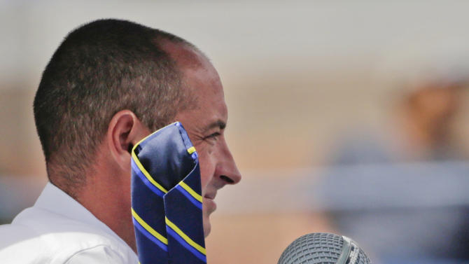 The umpire, Pascal Maria, watches over a semifinal match between Britain's Andy Murray and Czech Republic's Tomas Berdych as his tie is blown by the wind at the 2012 US Open tennis tournament,  Saturday, Sept. 8, 2012, in New York. (AP Photo/Charles Krupa)