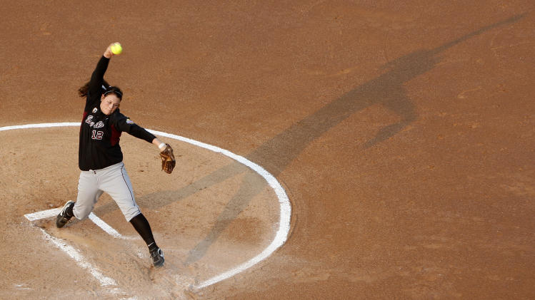 Arizona State's Dallas Escobedo pitches against Florida in the first inning of a Women's College World Series championship series game in Oklahoma City, Tuesday, June 7, 2011. (AP Photo/Sue Ogrocki)