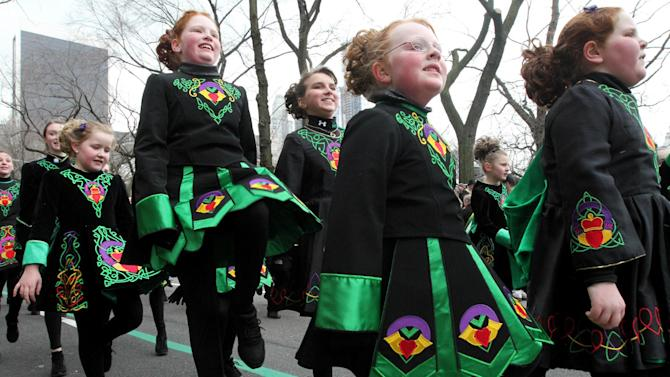 Members of the Emerald Isle Step Dancers, from Wilkes-Barre, Pennsylvania,  make their way up New York's Fifth Avenue as they take part in the St. Patrick's Day Parade Saturday,  March 16, 2013. (AP Photo/Tina Fineberg)