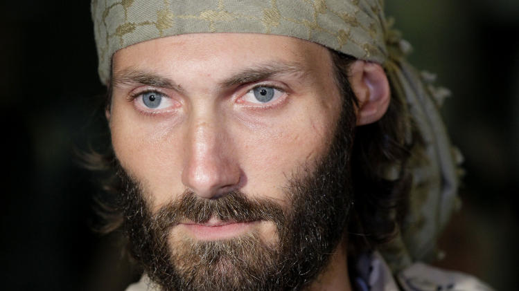 Matthew VanDyke, who spent months in Libyan prisons before joining rebel forces who opposed dictator Moammar Gadhafi, speaks with reporters after his flight arrived at Baltimore-Washington International Airport in Linthicum, Md., Saturday, Nov. 5, 2011. (AP Photo/Patrick Semansky)
