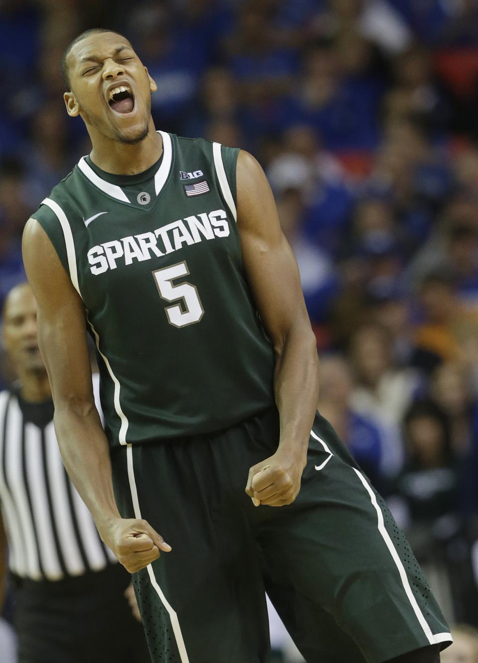Michigan State center Adreian Payne (5) reacts during the second half of an NCAA college basketball game against Kansas at the Georgia Dome in Atlanta Tuesday, Nov. 13, 2012. Michigan State beat Kansas 67-64. (AP Photo/Dave Martin)