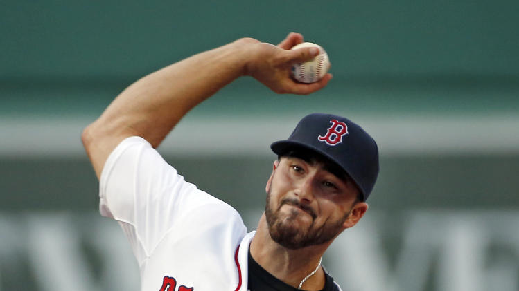 Boston Red Sox starting pitcher Brandon Workman delivers to the Toronto Blue Jays during the first inning of a baseball game at Fenway Park in Boston, Wednesday, July 30, 2014. (AP Photo/Elise Amendola)