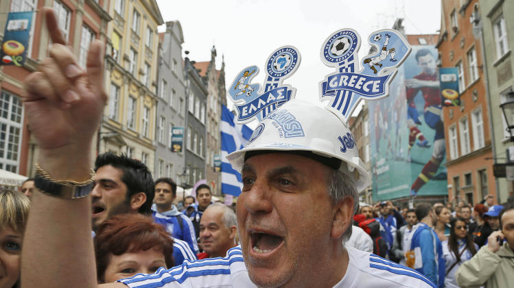 Greece soccer supporters celebrate ahead of the Euro 2012 soccer championship quarterfinal match between Germany and Greece in Gdansk, Poland, Friday, June 22, 2012. (AP Photo/Frank Augstein)