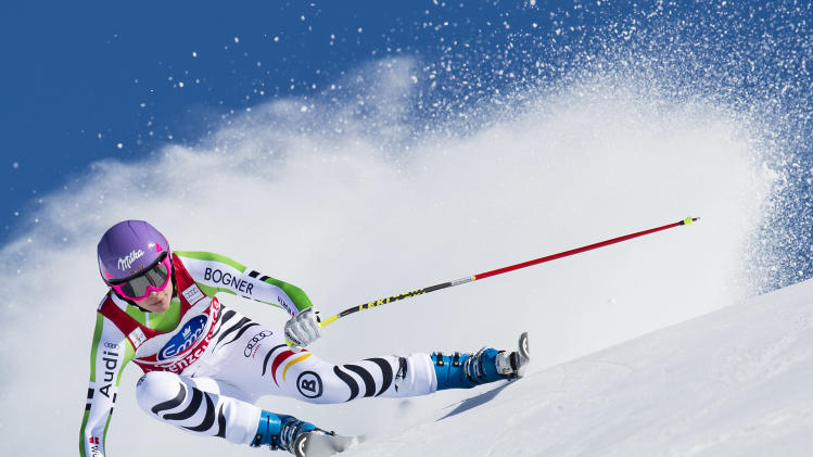 Maria Hoefl-Riesch of Germany speeds down the course during the women's downhill race at the FIS Alpine Ski World Cup finals, in Lenzerheide, Switzerland, Wednesday, March 12, 2014. (AP Photo/Keystone,Jean-Christophe Bott)