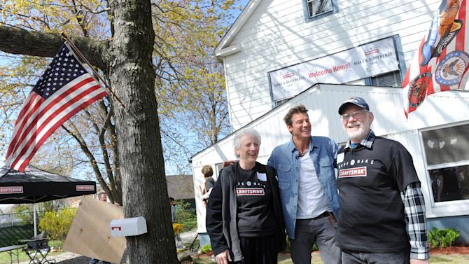 "IN THIS IMAGE DISTRIBUTED FOR CRAFTSMAN -  TV personality and DIY expert Ty Pennington, center, greets veteran Pete Peterson and his wife Millie outside their home in Moonachie, N.J., on National Rebuilding Day, Saturday, April 27, 2013, before helping to restore their home damaged by Superstorm Sandy as part of the Craftsman ""Make A Difference"" Tour. (Diane Bondareff/Invision for Craftsman/AP Images)"