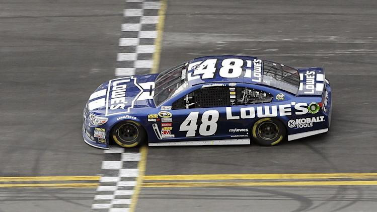 Jimmie Johnson crosses the finish line to win the Daytona 500 NASCAR Sprint Cup Series auto race, Sunday, Feb. 24, 2013, at Daytona International Speedway in Daytona Beach, Fla. (AP Photo/Chris O'Meara)