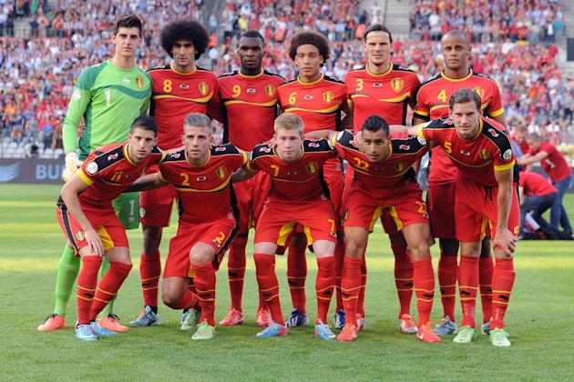 In this June 7, 2013 file photo, Belgium soccer team poses prior to the start the World Cup Group A qualifying soccer match between Belgium and Serbia at the King Baudouin Stadium in Brussels. Foregro