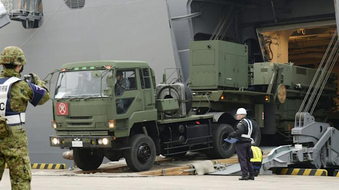 A Japanese Self-Defence Forces' vehicle carrying units of PAC-3 missiles leaves a port on Japan's southern island of Ishigaki, Okinawa prefecture