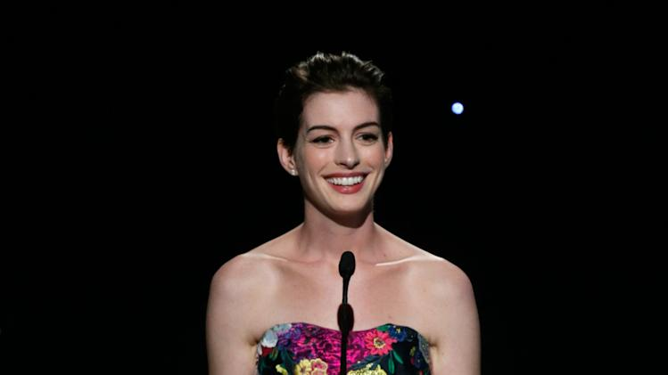 IMAGE DISTRIBUTED FOR THE PRODUCERS GUILD - Anne Hathaway presents the David O. Selznick award to Tim Bevan and Eric Fellner (Working Title) at the 24th Annual Producers Guild (PGA) Awards at the Beverly Hilton Hotel on Saturday Jan. 26, 2013, in Beverly Hills, Calif. (Photo by Todd Williamson/Invision for The Producers Guild/AP Images)