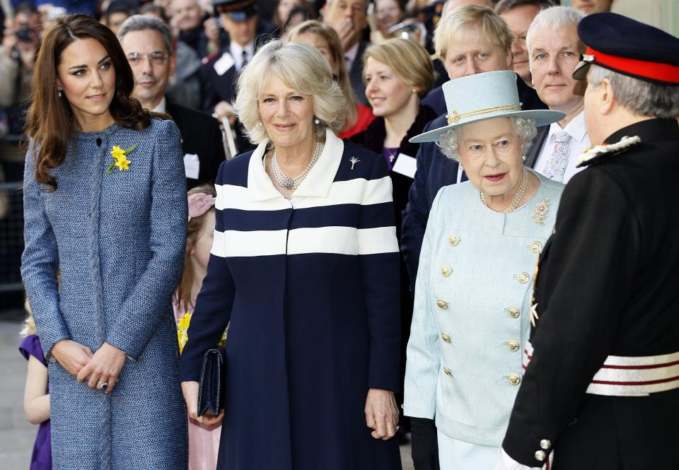 Britain's Queen Elizabeth II, right, Camilla, Duchess of Cornwall, centre, and Kate, Duchess of Cambridge stand outside the Fortnum and Mason department store for a ceremony to unveil a plaque to commemorate the regeneration of Piccadilly in central London, Thursday, March, 1, 2012. (AP Photo/Alastair Grant)