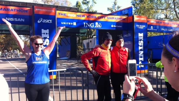 Dressed to run, people pose for photos at the finish line for the 2012 New York Marathon, Saturday, Nov. 3, 2012 in New York's Central Park. NYC Mayor Michael Bloomberg canceled the marathon on Friday, Nov. 2, amid rising criticism as he planned to go ahead with the race less than a week after much of New York City was damaged by Superstorm Sandy. (AP Photo/Cara Ana)