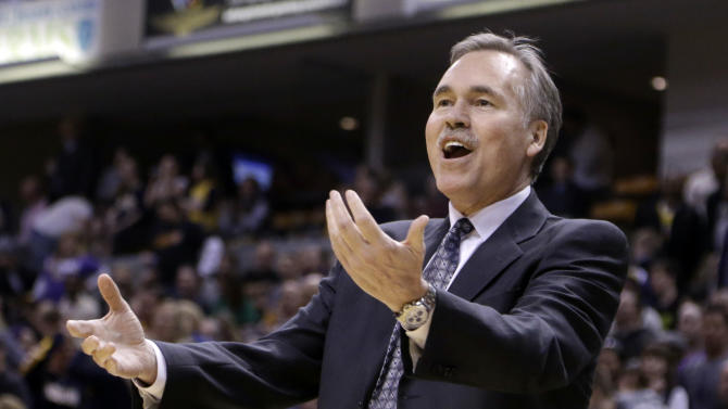 Los Angeles Lakers coach Mike D'Antoni questions a call in the first half of an NBA basketball game against the Indiana Pacers in Indianapolis, Friday, March 15, 2013.  (AP Photo/Michael Conroy)