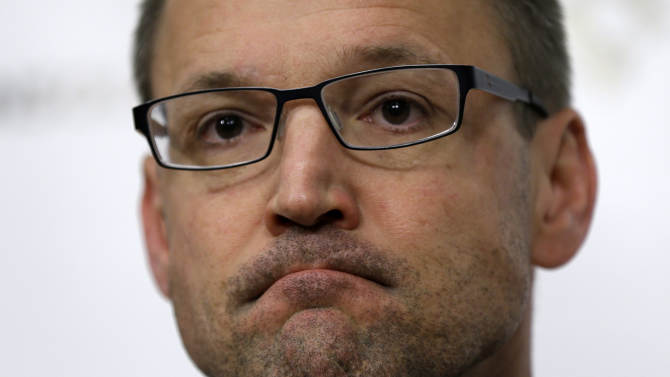 Pittsburgh Penguins head coach Dan Bylsma meets with reporters as players cleared out their lockers at the Consol Energy Center in Pittsburgh, Sunday, June 9, 2013. The Boston Bruins swept the Penguins in four games during the Eastern Conference Stanley Cup NHL hockey finals. (AP Photo/Gene J. Puskar)