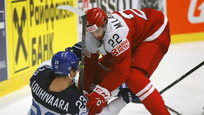 Finland's Louhivaara scuffles with Denmark's Lauridsen during their Ice Hockey World Championship game at the CEZ arena in Ostrava