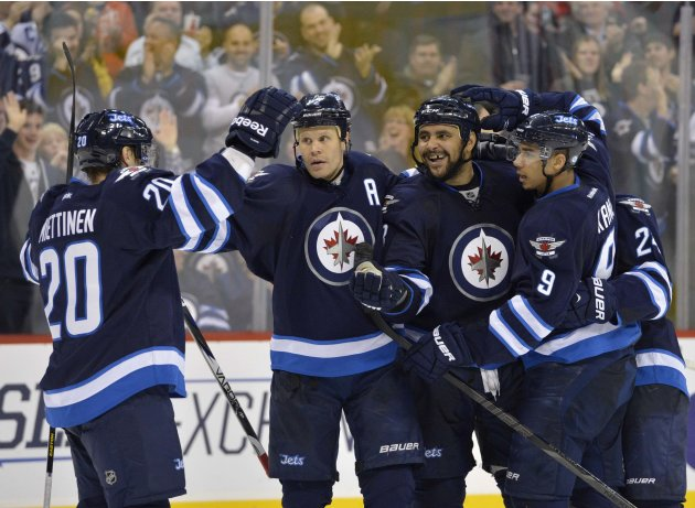 Jets' Miettinen celebrates his goal against the Rangers with Jokinen, Byfuglien and Kane during the second period of their NHL hockey game in Winnipeg