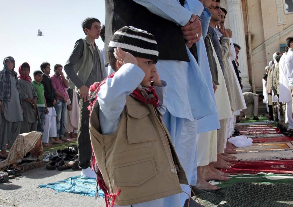 Afghans offer the Eid al-Fitr's prayers outside Shah-e- Dushamshera's mosque that marks the end of holy fasting month of Ramadan in Kabul, Afghanistan, Sunday, Aug. 19, 2012. (AP Photo/Musadeq Sadeq)