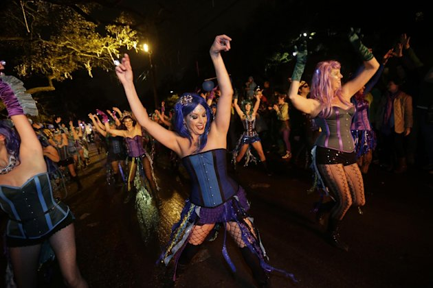 Members of the Mardi Gras dance group &quot;The Sirens&quot; perform during the Krewe of Orpheus Mardi Gras parade in New Orleans, Monday, Feb. 11, 2013. (AP Photo/Gerald Herbert)
