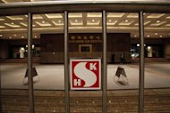 Company logo of Sung Hung Kei Properties is seen outside its headquarters in Hong Kong