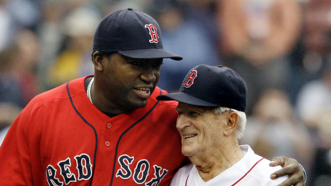 FILE - In this Sept. 28, 2008, file photo, Boston Red Sox's David Ortiz, left, hugs Red Sox great Johnny Pesky after the ceremonial first pitch during ceremonies retiring Pesky's No. 6 at Fenway Park prior to a baseball game against the New York Yankees in Boston. Pesky, who spent most of his 60-plus years in pro baseball with the Red Sox and was beloved by the team's fans, has died on Monday, Aug. 13, 2012, in Danvers, Mass. He was 92. (AP Photo/Elise Amendola, File)