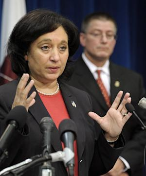 Drug Enforcement Administration (DEA) Administrator Michele Leonhart, left, accompanied by James Chaparro, acting director, Immigration and Customs Enforecement Office of Homeland Security Investigations, gestures during a news conference at DEA headquarters in Arlington, Va., Thursday, July 26, 2012, to announce of a nationwide synthetic drug takedown.  (AP Photo/Cliff Owen)