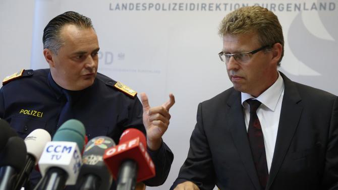 Head of Burgenland province police Doskozil talks with Prosecutor Fuchs during a news conference in Eisenstadt